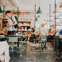 A busy cafe full of customers enjoying themselves | Finsure UK