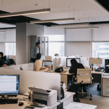 An office environment with employees at their workstations | Finsure UK