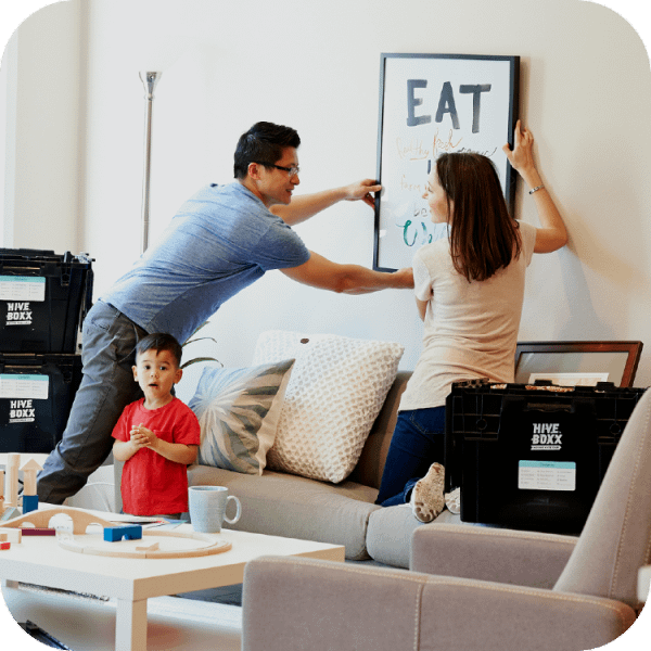 A young couple with their son unpack furniture in a new home | Finsure UK