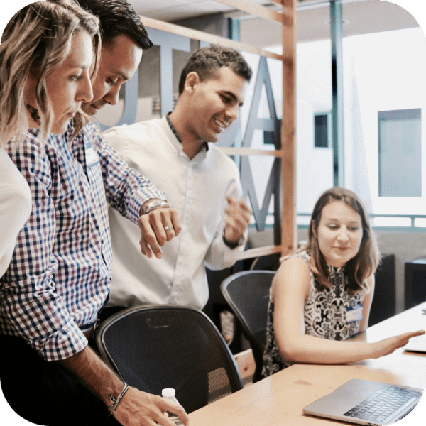 A group of employees having a discussion about a business proposal | Finsure UK