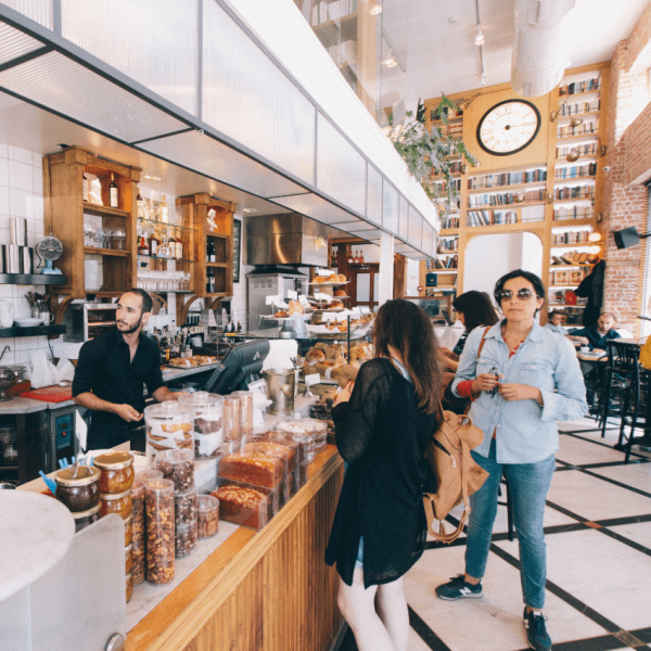 Two female customers being served by a barista in a coffee shop | Finsure UK