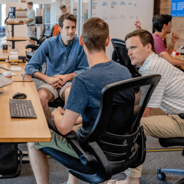 Three men dressed casually having an informal meeting in the office | Finsure UK